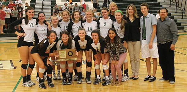 The De Soto High School volleyball team celebrates after earning a State tournament berth following the teams Sub-State championship held at De Soto High School on Oct. 25.