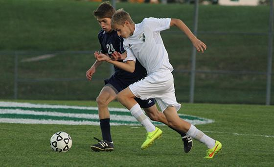 Junior center midfielder Luke Zoller races past his Eudora opponent during the DHS 10-0 win in the opening round of Regionals on Oct. 28 at De Soto High School.