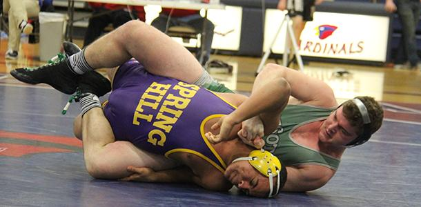 Senior Chandler Carter attempts to pin his Spring Hlll opponent at the Frontier League Tournament.