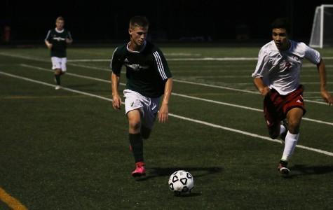 Boys' varsity soccer wins by deflection