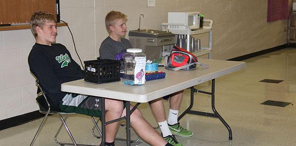 Sophomore Noah Wilson and senior Hunter Corneliusen sell raffle tickets at lunch.