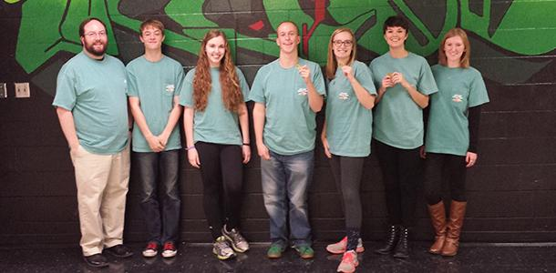 The De Soto High School Scholars Bowl team poses with their medals on Jan. 11 after winning the Frontier League tournament.