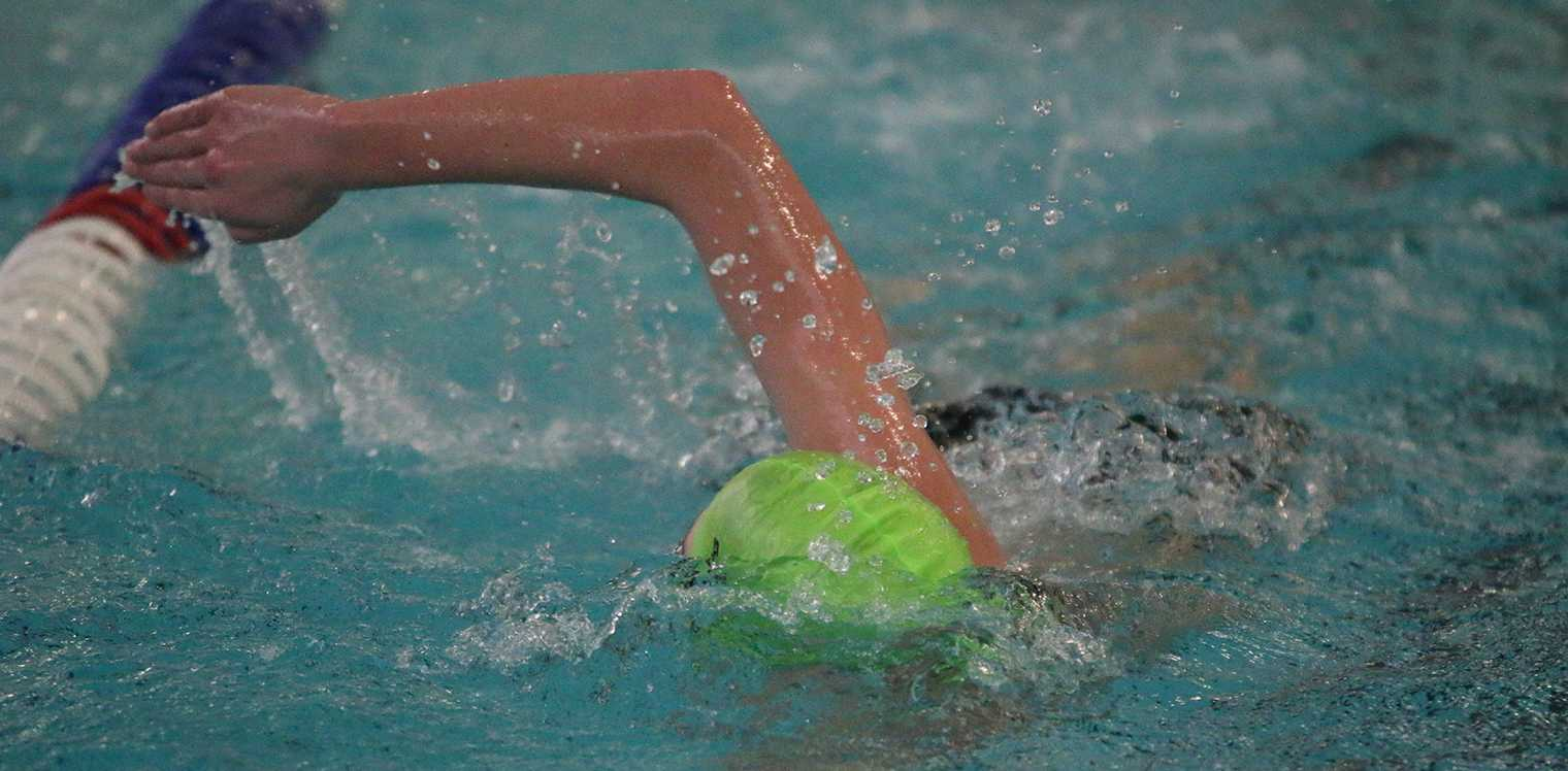 Junior Julian Longerich swims freestyle at a practice on Jan. 22.