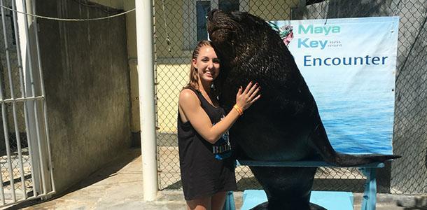Fowks hugs a sea lion at an animal refuge in Maya Key.