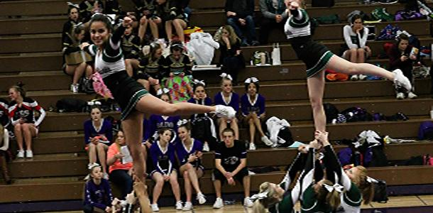 DHS cheer team preforming at the Baldwin Cheer and Dance Festival.