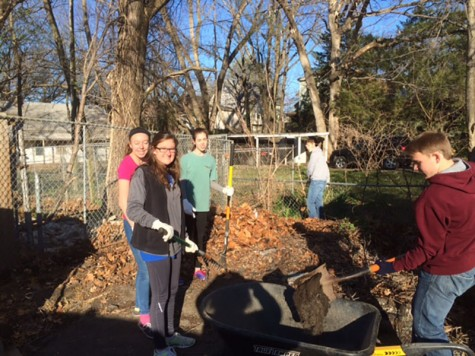 NHS members doing yard work at the Bonner Springs Animal Shelter.