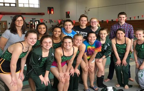 Girls' swim team competes with new coach