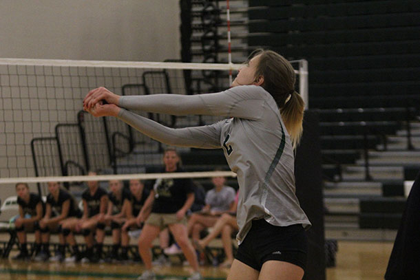 Sophomore Cassidy Crist prepares to pass a volleyball at a game against Paola High School on Tuesday, Sept. 6.