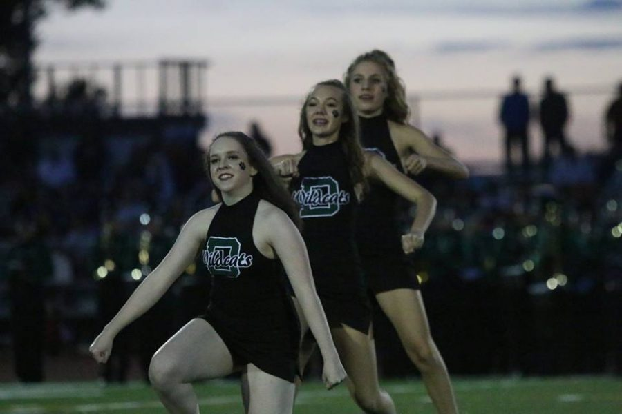 Junior Charisa Dodd and freshmen Jolie Dobosz and Ellie Warners perform at half time of the DHS football game on Friday Sept. 2