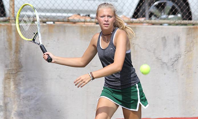 Junior Carly Bodenhausen prepares to hit a forehand during pool play at the Baldwin Invitational, Sept. 14.