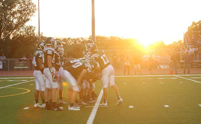 The De Soto High School varsity football team offense prepares for the next play against Louisburg High School on Sept. 16.
