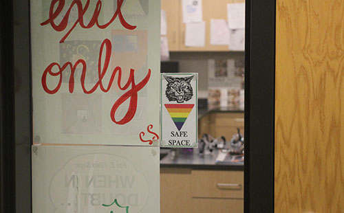 A safe space card hangs in the window of science teacher Laura Sixta.