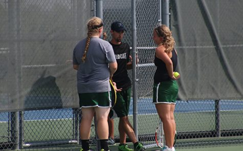 Senior Emily Euler (right) and junior Kelsey Heer get advice from head coach Justin Hoffman durning a changeover of a match at the Wildcat Invitational on Sept. 24