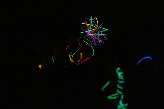 Marching band members light up their instruments at the fourth annual glow show on Friday, Oct. 21.