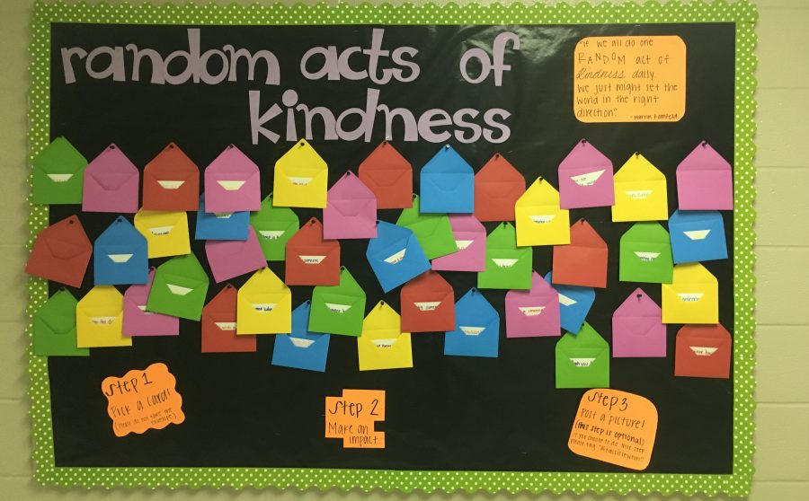 The+Random+Acts+of+Kindness+board+is+displayed+in+the+FACS+hallway+across+from+FACS+teacher+Caroline+Friday%27s+room.+Students+can+come+to+the+board%2C+pick+a+card+and+follow+the+instructions+given+to+show+a+friend+a+random+act+of+kindness.