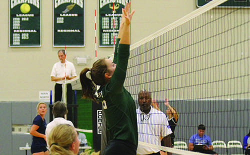 Senior middle hitter Jackie Kennard goes up to block a hit at the Spikefest tournament on Oct. 8.