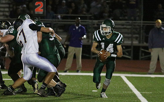 Sophomore Brandon Taylor plays quarterback in the game varsity game against Spring Hill High School on Oct. 14.