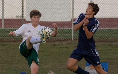 Sophomore Daniel Apple volleys the ball past a Eudora defender on Oct. 3.