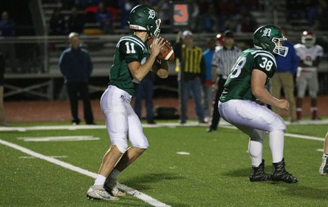 Junior Connor Strouse plays quarterback against Bishop Miege High School on Oct. 21. The Wildcats fell to BMHS 50-0.