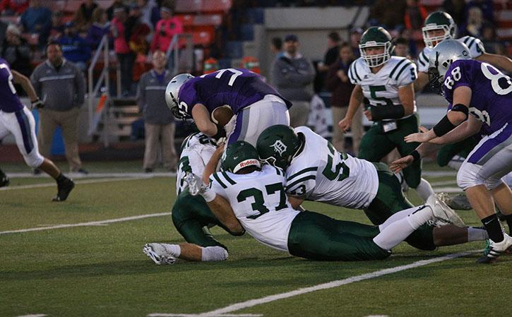 The De Soto defense tackles a Baldwin running back on Oct. 7. DHS eventually won 43-0 over BHS.