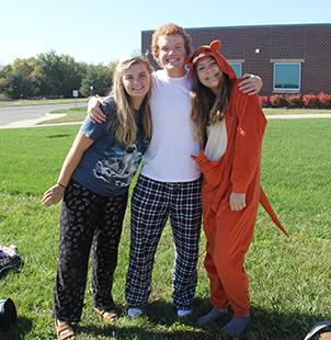 Left to right: Lizzy Arnold, Simon Couch and Aspen Grieshaber participate in pajama day on Oct. 18.