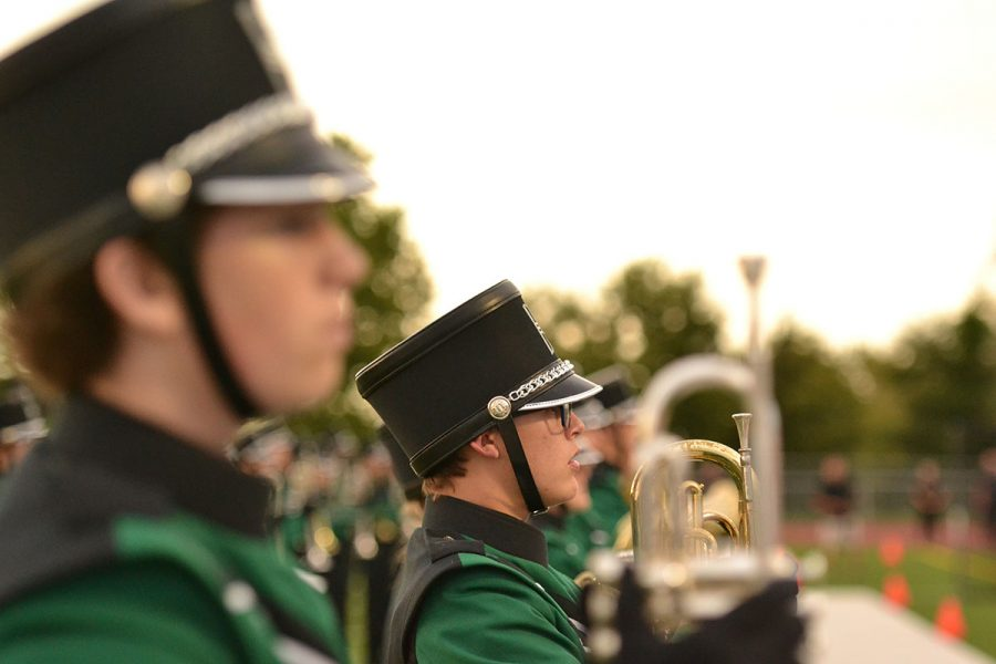 The De Soto band preparing to march at a home football game.