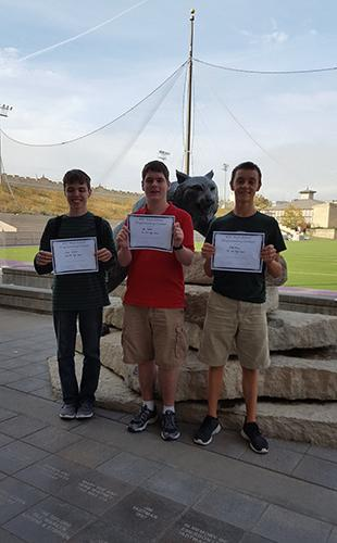 Juniors Zach Delbert, Cody Moose and Alex Webber stand with their first place certificates after the competition on Nov. 1st.