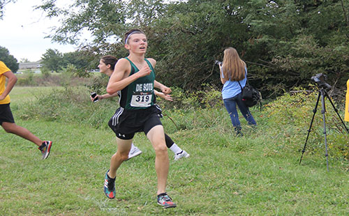 Sophomore Sam Hubert races to the finish line during the cross country meet at Shawnee Mission Park.
