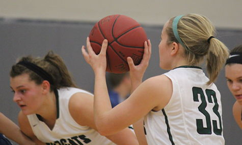 Junior Mariah Grizzle waits for senior Madison Plake to take a free throw shot at the championship game on Dec. 10