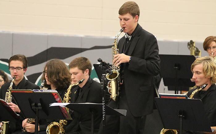 Senior Ryan Wollum performs a solo with the jazz band at the holiday concert on Dec. 1.