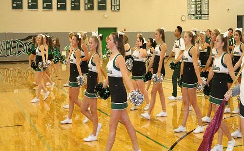 Kira Horn cheers with the De Soto High School cheer team on Freshman Day.