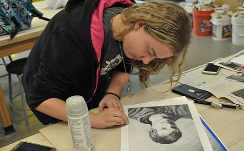 Senior Emily Euler works on an art piece she submitted for Shooting Stars