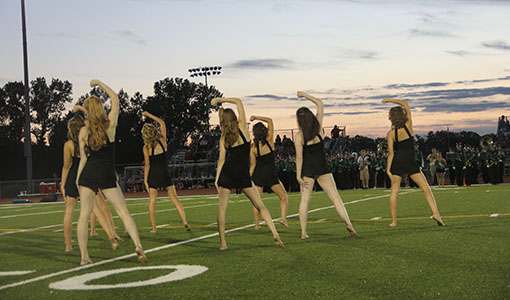 The Diamonds Dance team performs during half-time at a De Soto High School football game.