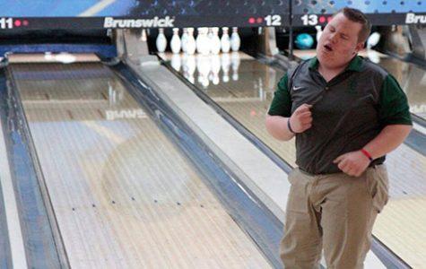 Freshman Sean Cauthron celebrates after bowling his turn in a meet.