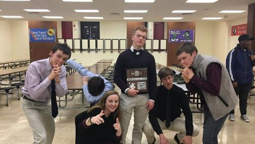 Varsity Scholars Bowl team poses with their state plaque on Feb. 2.