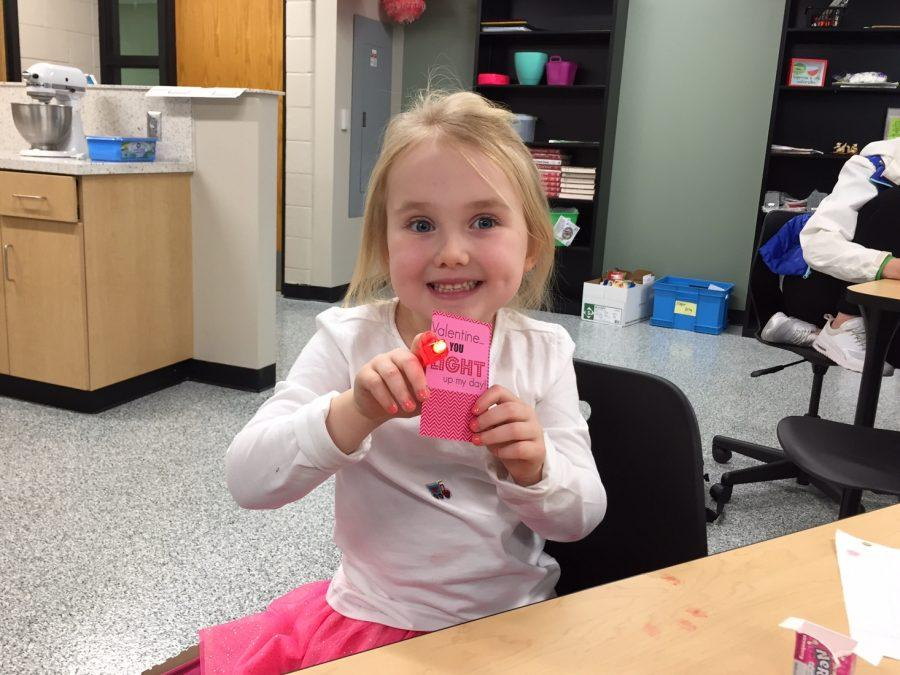 Harper Friday, daughter of FACS teacher Caroline Friday, poses with a homemade valentine.