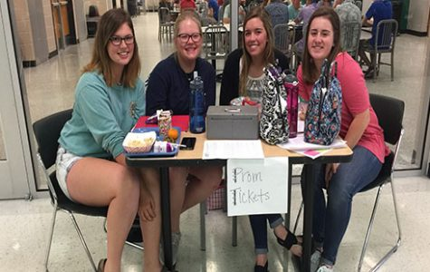 Juniors Josie Bedford, Hannah Knight, Payton Faddis and Rachael Hopkins sell prom tickets at lunch on April 19.