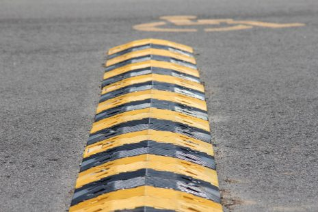 A Speed Bump positioned outside of De Soto High School