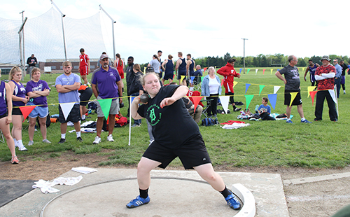 Junior Kelsey Heer competes in shot put in a home track meet.