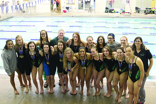 The girls' swim team poses with their medals after winning League in Osawatomie on May 10.