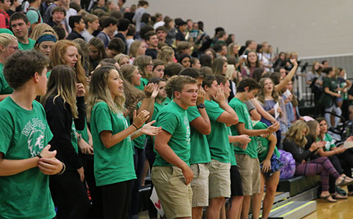 Upperclassmen mentors sing the DHS fight song with freshmen on August 16.