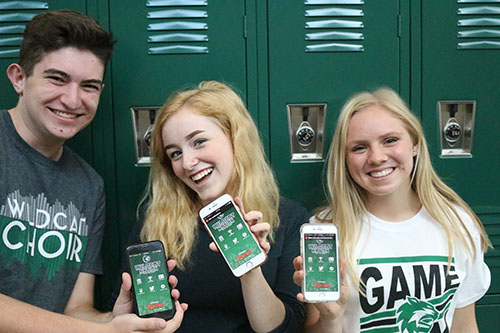 Several Green Pride staff members showing off the new Wildcat Nations app on August 25.