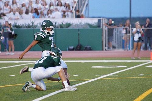 Senior Ethan Rodriguez, who plays for both the DHS soccer and football teams, kicks a PAT during the 2016 season.