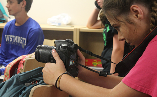Junior Caroline Whipple records the weekly video announcements for Student Council on Aug. 30.