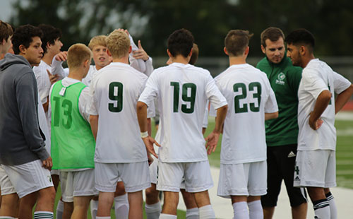 De Soto High School varsity soccer meets to strategize prior to game with Ottawa on Sept. 26.
