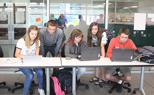 Advanced debate students mentor the novice debaters after school on Sept. 19.