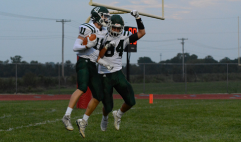 Seniors Connor Strouse and Kyle Bell celebrate after scoring against Ottawa on Sept. 1. Under the new classifications, DHS is unlikely to play Ottawa.