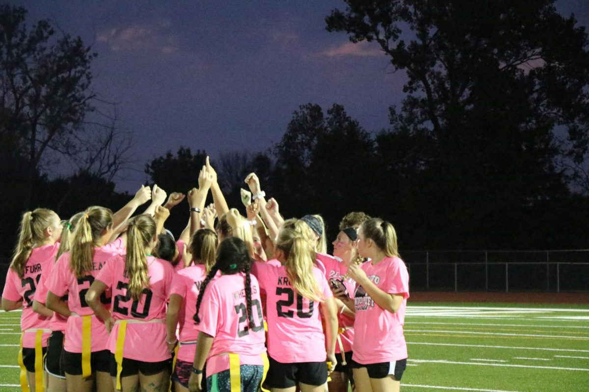 The sophomore team huddles before the first play at the powder puff football game on Sept. 20. Photo by Rylee Wilson.