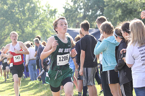 Sophomore Jack Loomis races to the finish line at Wyandotte Park on Sept. 16.