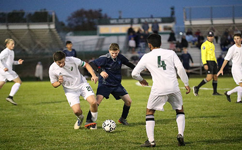 Senior Andrew Goodman fights for the ball while junior Rohan Singh prepares to defend on Oct 24.